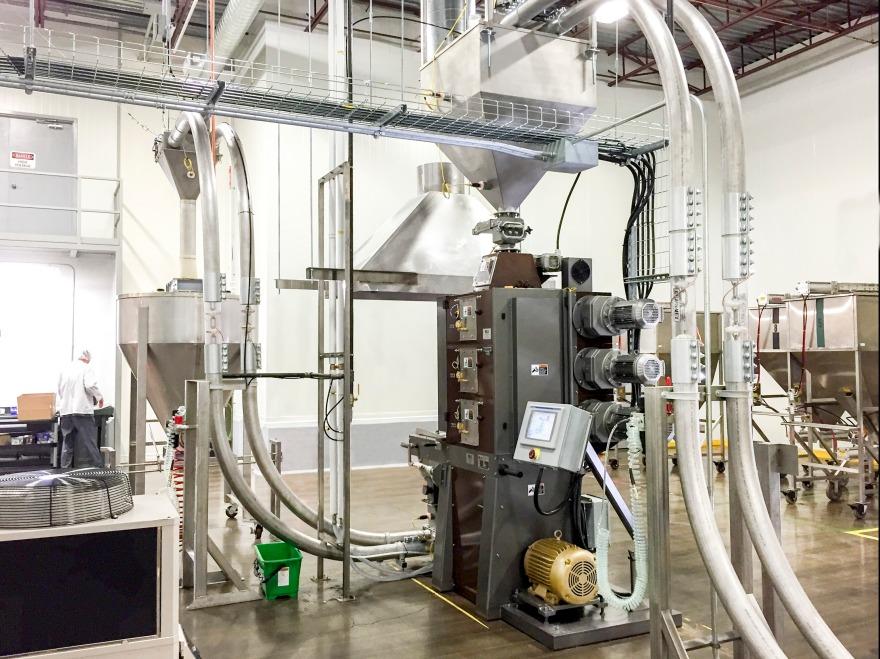 Chain-Vey tubular drag conveyor systems at a coffee roasting facility
