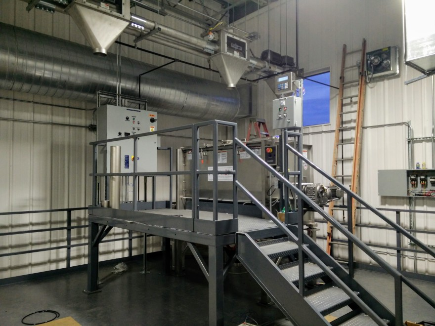Marion coffee mixer atop of mezzanine at Verena facility