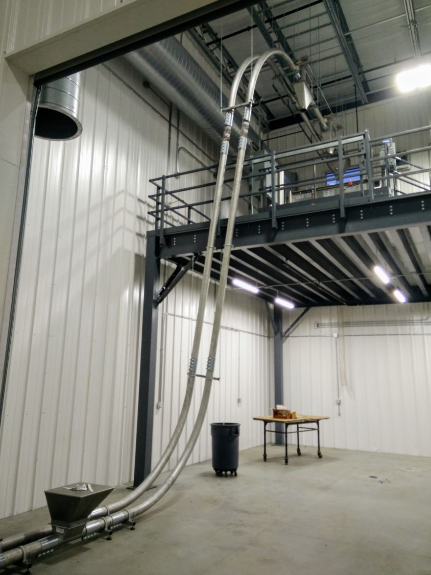 Tube conveyor system inside Verena's coffee facility